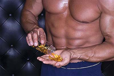 Bodybuilder taking supplements