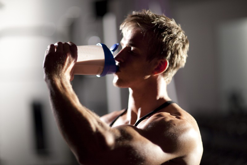 Athlete drinking protein shaker